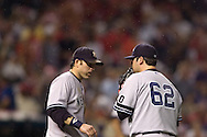 Doug Mientkiewicz, left, makes a visit to Joba Chamberlain during a bug attack in  Game 2 of the 2007 ALDS at Jacobs Field in Cleveland.