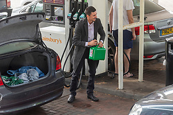 © Licensed to London News Pictures. 26/09/2021. London, UK. A motorist fills a container with fuel at a Sainsbury's petrol station in Alperton, West London as it reopens. There has been problems with the supply and distribution chain. Companies including BP and Shell have restricted deliveries due to the lack of HGV drivers. Photo credit: London News Pictures