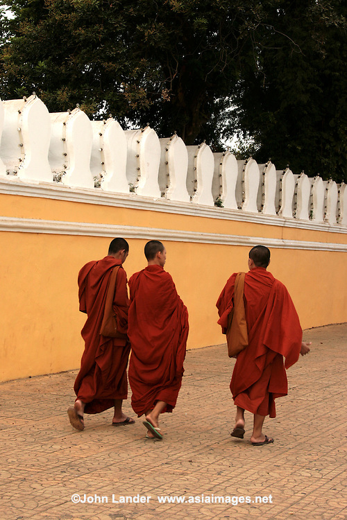 Monks out for a stroll in front of the Royal Palace, Phnom Penh - Buddhism in Cambodia is a form of Theravada Buddhism and has existed in Cambodia since at least the 5th century. Theravada Buddhism has been the Cambodian state religion since the 13th century except during the Khmer Rouge period, and is estimated to be the faith of 95% of the population