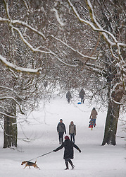 © Licensed to London News Pictures. 28/02/2018. London, UK. Picturesque scenes as people walk through Primrose Hill, West London following heavy snowfall last night. Large parts of the UK are experiencing disruption as 'Storm Emma' hits, following Russian a cold front earlier in the week named 'The Beast From The East'. Photo credit: Ben Cawthra/LNP