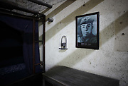 A picture of Mao Zeming, Mao Zedong's younger brother, hangs in Zeming's bedroom at their former home and birthplace in Shaoshan, Hunan Province, China on 12 August 2009.  The village of Shaoshan, in rural Hunan Province, is tiny in size but big in name. It was the childhood home for Mao Zedong, the controversial revolutionary who came from obscurity but eventually defied all odds conquered China in the name of communism. Now his home, a sacred place among China's official propaganda, is in reality a microcosm of the country itself: part commercialism, part superstition, with a dash of communist ideological flavor.
