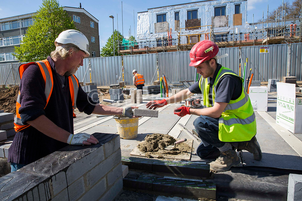 Builders laying the foundations of a new house on a home building construction site in Norwich. Norfolk. United Kingdom. photo by Andrew Aitchison / In pictures via Getty Images