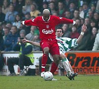 Photo. Andrew Unwin<br /> Yeovil v Liverpool, FA Cup Third Round, Huish Park, Yeovil 04/01/2004.<br /> Yeovil's Nicholas Crittenden (r) tries to tackle Liverpool's El Hadj Diouf (l).