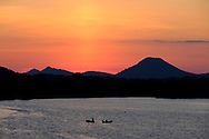 Two fisherman chat tell tall tales as the sun sets over Pinnacle Mountain on the Arkansas River near Little Rock, AR