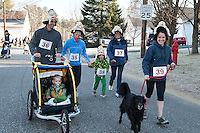 The Butler family get into the Thanksgiving spirit as they head out for the annual Gilford Youth Center's 5k Turkey Trot Thursday morning.  (Karen Bobotas/for the Laconia Daily Sun)