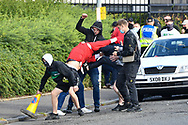 Fans fight with each other outside Tynecastle Park, Edinburgh, Scotland before the Cinch SPFL Premiership match between Heart of Midlothian FC and Celtic FC on 31 July 2021.