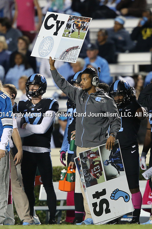 18 October 2014: UNC assistants call plays on the sideline using play calling cards. The University of North Carolina Tar Heels hosted the Georgia Tech Yellow Jackets at Kenan Memorial Stadium in Chapel Hill, North Carolina in a 2014 NCAA Division I College Football game. UNC won the game 48-43.