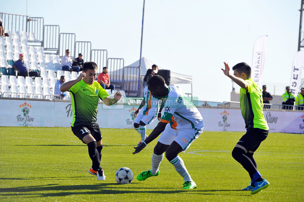 October 9, 2017 - Nabeul, Tunisia - Diane Amara(11) of Ivory coast,Akhmetshampov Murat(11) and Barlybayen Assan(9) of Kazakhstan in action during the second day of the group stage of the WMF World of Mini Foot 2017, played in Nabeul (60km south of Tunis) between Kazakhstan and the Ivory coast. (Credit Image: © Chokri Mahjoub via ZUMA Wire)