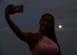 January 1, 2018 - Natal, RN, Brazil - The first super moon of 2018 is seen from Ponta Negra beach. A super moon is a moon that is full and at its closest point in orbit around the Earth. This period is called perigee, when it appears about 14% larger and 30% brighter. (Credit Image: © Nuno Guimaraes/Pacific Press via ZUMA Wire)