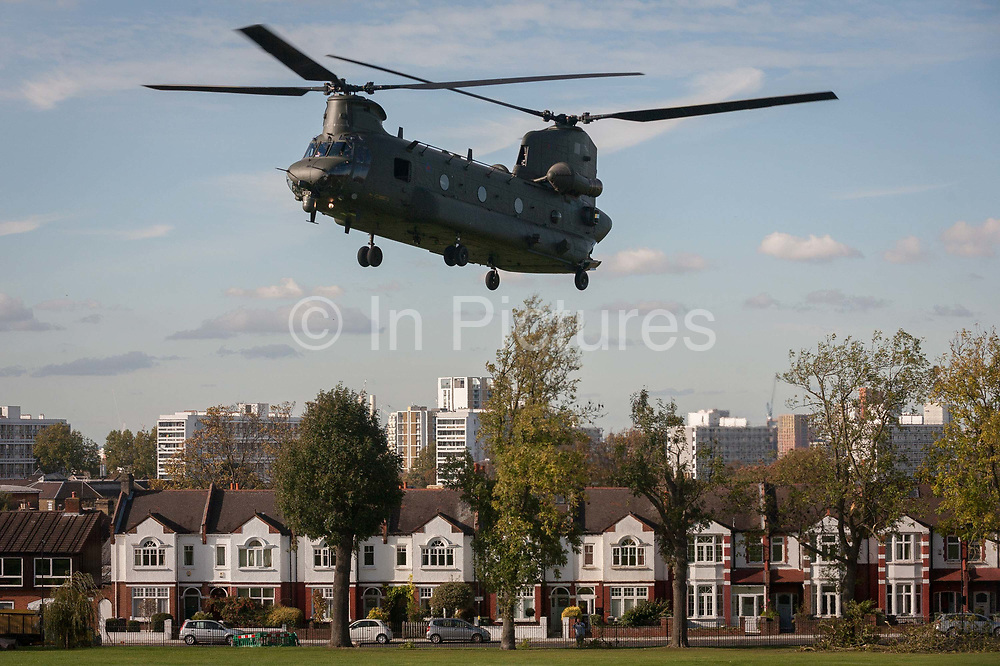 An army Chinook military helicopter takes off over Edwardian period homes line Finsen Road on Ruskin Park, on 25th October 2017, in south London, England. RAF and Army helicopters occasionally land in this public space in order to familiarise air crew to potential evacuation zones in times of national crisis.