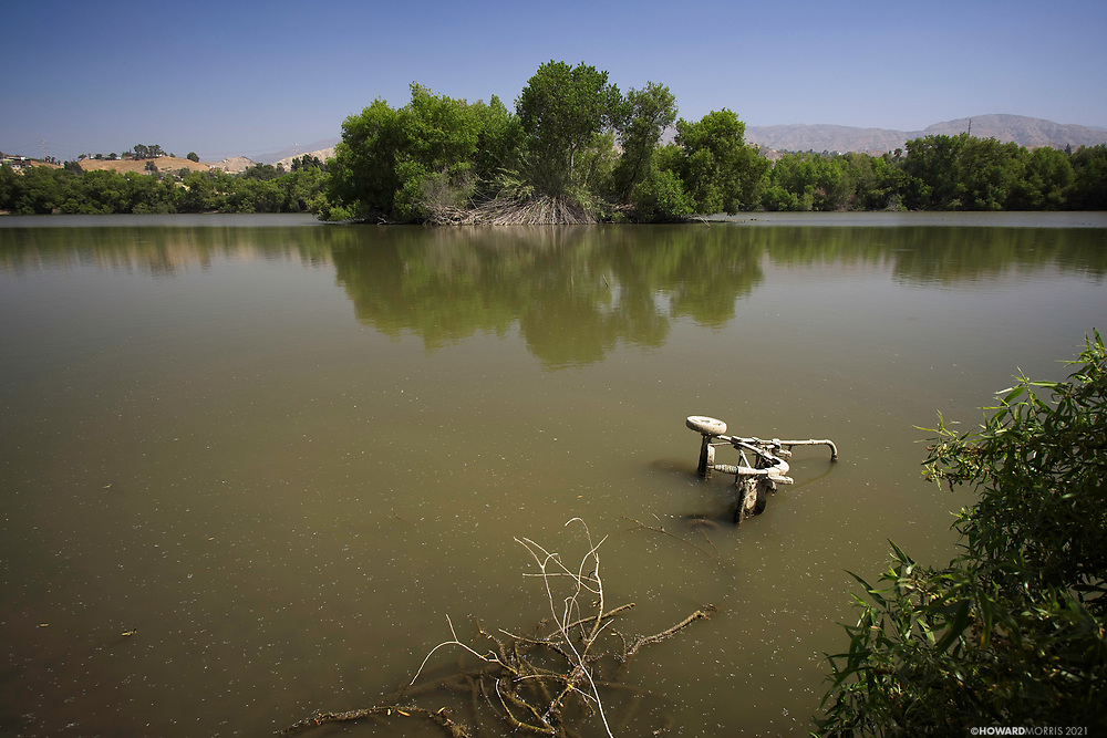 """In the mid-1940s, the Hansen Dam Basin attracted thousands of visitors every year. Holiday Lake was created in 1952 , and was used by swimmers, boaters, and anglers. By 1991, the lake had become completely filled with sediment and was abandoned. In 2015 a $300,000 cleanup effort was initiated to remove homeless encampments. <br /> According to the City of Los Angeles Department of Recreation and Parks (in 2013) and Wkipedia, """"Recreation Center and Park features a moderate size lake which is filled with circulated drinking water and offers fishing and public boating. The lake is open year-round, including holidays, but may be closed during times of severe weather or for planned events."""""""