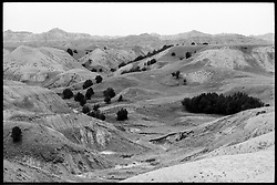 Badlands, South Dakota, B&W photograph showing soil conditions, texture of rain wash and other ground details.
