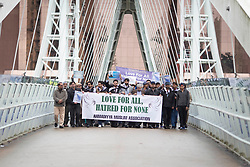 © Licensed to London News Pictures. 29/03/2017.   SALFORD , UK.  <br /> Members of the Manchester Multi-Faith Netowrk and Ahmadiyya Muslims on the Lowry Bridge , Salford Quays , Greater Manchester. They joined hands and stretched across the bridge in a show of solidarity one week on from the terrorist attack in London. It was part of a national event where groups did the same across the country.<br /> <br /> Photo credit: CHRIS BULL/LNP