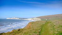 Running along the Isle of Wight coastal path at Compton Bay