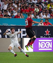 July 31, 2018 - Miami Gardens, Florida, USA - Manchester United F.C. defender Luke Shaw (23) heads the ball above Real Madrid C.F. defender Alvaro Odriozola (19) during an International Champions Cup match between Real Madrid C.F. and Manchester United F.C. at the Hard Rock Stadium in Miami Gardens, Florida. Manchester United F.C. won the game 2-1. (Credit Image: © Mario Houben via ZUMA Wire)