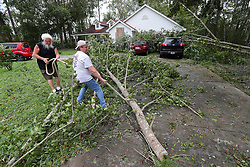 Adam Travis, right, gets some help removing trees that fell on his home and two cars from his friend Ed Long after Hurricane Irma swept through the city on Monday, September 11, 2017, in Kingsland, GA, USA. Photo by Curtis Compton/Atlanta Journal-Constitution/TNS/ABACAPRESS.COM