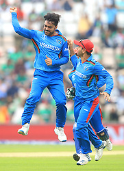 Afghanistan's Rashid Khan (left) celebrates the wicket of Bangladesh's Shakib Al Hasan before it was overturned during the ICC Cricket World Cup group stage match at The Hampshire Bowl, Southampton.