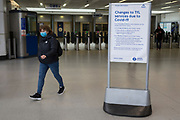 As the Coronavirus pandemic spreads across the UK, businesses and entertainment venues not already closed with the threat of job losses, struggle to stay open with growing rumours of a lockdown and travel restrictions around the capital. Londoners start to work from home leading to a quiet concourse at Blackfriars railway station where a schedule changes notice awaits travellers on the main councourse, on 19th March 2020, in London, England.
