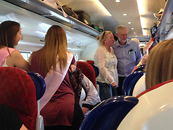 **FILE PICTURE - Monday December 21 marks 100 days since Jeremy Corbyn became leader of the Labour Party**© Licensed to London News Pictures. 02/10/2015.  Labour leader JEREMY CORBYN talking to a group of women on a hen night out while on a train journey during his visit to Scotland yesterday (Thurs).  Photo credit: Henry Bell/LNP