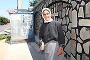 Geta en 2011, devant le monastère où elle est devenue nonne dans la grande banlieue de Bucarest. Aujourd'hui, Geta est toujours nonne dans le même monastère. Elle a changé de nom et s'appelle Soeur Cristofora. <br /> <br /> In front of the monastery where she became a nun.<br /> <br /> Bucarest, 2011