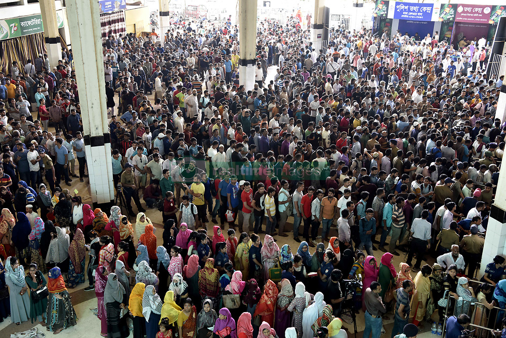 May 26, 2019 - Dhaka, Bangladesh - Bangladeshi travelers queue to collect tickets at the Kamalapur railway station in Dhaka, on May 26, 2019, as Bangladesh Railways starts selling advance tickets ahead of Eid ul-Fitr. Eid-ul-Fitr, the biggest festive Muslim event, marks the end of the holy fasting month of Ramadan and will fall on or around June 6, depending upon moon sightings. (Credit Image: © Str/NurPhoto via ZUMA Press)