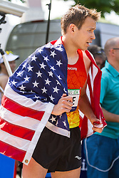 UAE Healthy Kidney 10K, Ben True draped in USA flag after winning