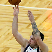 ORLANDO, FL - MARCH 01: Luka Doncic #77 of the Dallas Mavericks shoots the ball against the Orlando Magic at Amway Center on March 1, 2021 in Orlando, Florida. NOTE TO USER: User expressly acknowledges and agrees that, by downloading and or using this photograph, User is consenting to the terms and conditions of the Getty Images License Agreement. (Photo by Alex Menendez/Getty Images)*** Local Caption *** Luka Doncic