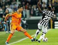 Kwadwo Asamoah (R) Juventus, Cristiano Ronaldo Real Madrid, <br /> Torino 05-11-2013<br /> Juventus Stadium<br /> Football Calcio 2013/2014 Champions League <br /> Juventus - Real Madrid<br /> Foto Marco Bertorello Insidefoto