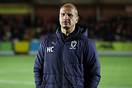 AFC Wimbledon assistant coach Neil Cox walking onto the pitch during the EFL Trophy group stage match between AFC Wimbledon and Stevenage at the Cherry Red Records Stadium, Kingston, England on 6 November 2018.