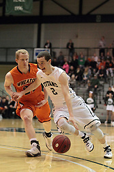 01 March 2014:  Dylan Overstreet during an NCAA mens division 3 CCIW  Championship basketball game between the Wheaton Thunder and the Illinois Wesleyan Titans in Shirk Center, Bloomington IL