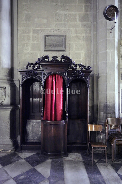 confessional with stacked chairs