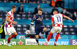 Scotland's Nathan Patterson (centre) and Croatia's Ante Rebic (right) battle for the ball during the UEFA Euro 2020 Group D match at Hampden Park, Glasgow. Picture date: Tuesday June 22, 2021.