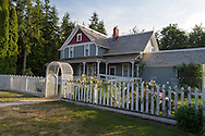 The Victorian farmhouse and heritage gardens at the historic Stewart Farm in Elgin Heritage Park in Surrey, British Columbia, Canada. The farmhouse was built in 1894 by Surrey pioneer John Stewart.