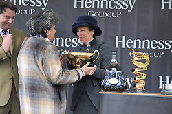 LADY OAKSEY receives the Hennessy Gold Cup from HRH The PRINCESS ROYAL watched by JO THORNTON MD Moet Hennessy UK at the Hennessy Gold Cup at Newbury Racecourse, Berkshire on 26th November 2011.