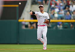 May 13, 2018 - Denver, CO, U.S. - DENVER, CO - MAY 13: Colorado Rockies infielder Nolan Arenado (28) fields a ground ball and throws to first base during a regular season MLB game between the Colorado Rockies and the visiting Milwaukee Brewers on May 13, 2018 at Coors Field in Denver, CO. (Photo by Russell Lansford/Icon Sportswire) (Credit Image: © Russell Lansford/Icon SMI via ZUMA Press)