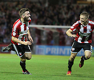 Brentford's Stuart Dallas celebrates the winner during the Sky Bet Championship match between Brentford and Derby County at Griffin Park, London, England on 1 November 2014.