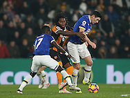 Dieumerci Mbokani of Hull City grapples with Gareth Barry of Everton during the English Premier League match at the KCOM Stadium, Kingston Upon Hull. Picture date: December 30th, 2016. Pic Simon Bellis/Sportimage