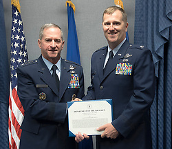 Lt. Col Daniel Finnegan receives the Koren Kolligian Trophy certificate from Air Force Chief of Staff Gen. David L. Goldfein in the Pentagon, Washington, D.C., June 25, 2018. (U.S. Air Force photo by Wayne A. Clark)