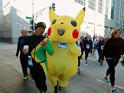 CHICAGO, Oct. 30, 2017  A runner dressed in Pokemon costume participates Chicago Hot Chocolate 15K/5K Race in Chicago, the United States, Oct. 29, 2017. 30,000 runners participated the 10th Chicago Hot Chocolate 15K/5K Race starting at Grant Park. Finishers are treated to goody bags, a mug of hot chocolate, and treats on top of a huge celebration.  yk) (Credit Image: © Wangping/Xinhua via ZUMA Wire)