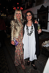 Left to right, VIRGINIA BATES and LAURA MERCIER at a party to celebrate the launch of Laura Mercier's perfume Ambre Pssion Elixir held at Momo's, 25-27 Heddon Street, London on 27th May 2010.