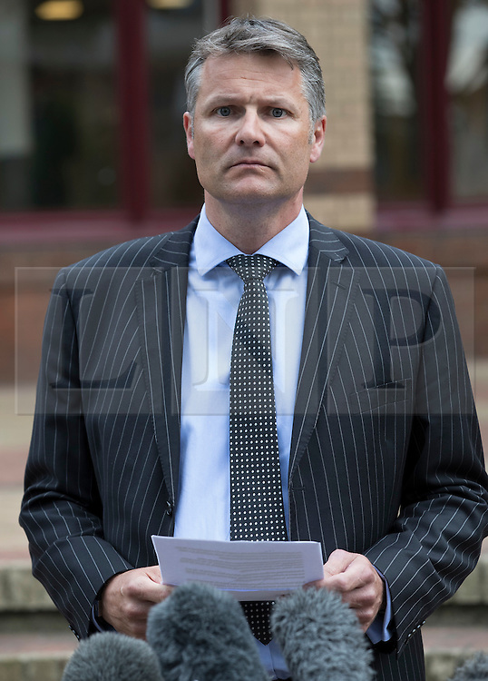 """© Licensed to London News Pictures. 03/06/2016. Woking, UK. Detective Superintendent Adam Hibbert, of Surrey Police talks to reporters outside Woking Coroner's Court. A second inquest into the death of army recruit Private Cheryl James has announced its verdict today. Coroner Brian Barker QC has ruled the death of Private James was caused by a """"self-inflicted"""" wound. Cheryl was found dead with a bullet wound to her head in November 1995.  Aged just 18 she was one of four young soldiers who died at the Deepcut Barracks in Surrey between 1995 and 2002, amid claims of bullying and abuse. Photo credit: Peter Macdiarmid/LNP"""
