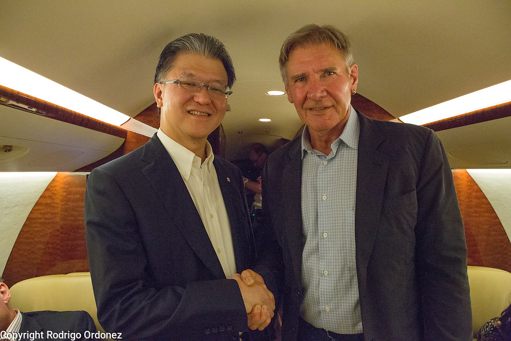 Palm oil executive Franky Oesman Widjaja (left) and actor and environmental activist Harrison Ford pose for a photograph onboard a private jet at Halim Perdanakusuma Airport in East Jakarta, Indonesia. Mr Widjaja is the Chairman and Chief Executive Officer of the Agribusiness & Food division of the Sinar Mas Group, one of the world's largest palm oil producers. <br /> Harrison Ford visited Indonesia to learn more about deforestation, as one of the correspondents for Showtime's new documentary series about climate change Years of Living Dangerously.