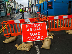 © London News Pictures. 02/03/2016. Aberystwyth, UK. <br /> A street closed as a safety precaution while inspection work is carried out to damed building in the town Aberystwyth as Storm Jake hits the Welsh coastline. <br /> 70mph gusts of wind have torn roof-slates off several of the older properties on seafront and brought down trees in the town centre. Photo credit: Keith Morris/LNP