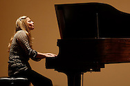 Montgomery, New York  - Heidi Breyer plays her music on the piano during the annual fundraiser for Music for Humanity at the Montgomery Senior Center on  Oct. 19, 2013.