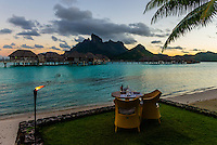 Outdoor dining on the lagoon, Four Seasons Resort Bora Bora, French Polynesia.