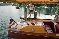 "Steve Clark at his dock on Cow Island, Lake Winnipesaukee - 19' 1949 Century ""Maiden '49"".  ©2018 Karen Bobotas Photographer"