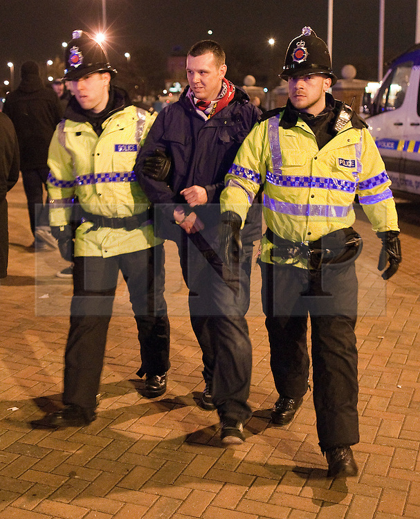 © licensed to London News Pictures. Manchester, UK  23/02/2012. Police detain a man at Old Trafford ahead of the Manchester United vs Ajax Amsterdam 2nd leg in the Europa League tie. Photo credit should read Joel Goodman/LNP