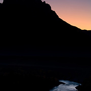 Silhouette of Grand Teton at sunset with the Snake River below.