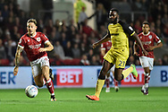 Bristol City striker Jamie Paterson (20) competes for the ball against Burton Albion midfielder Hope Akpan (21) during the EFL Sky Bet Championship match between Bristol City and Burton Albion at Ashton Gate, Bristol, England on 13 October 2017. Photo by Richard Holmes.