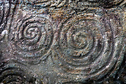 Spirals on the entrance stone at Newgrange. These patterns have various interpretations - hallucinogenic, spiritual, representing unity, of the sun, water and earth... who knows?..